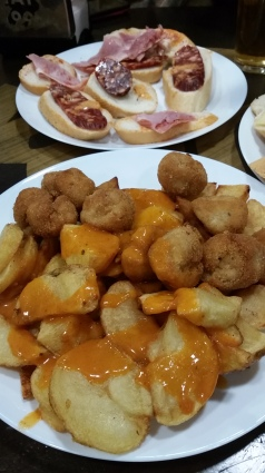Roast Potatoes with Sauce and Cheese Croquettas